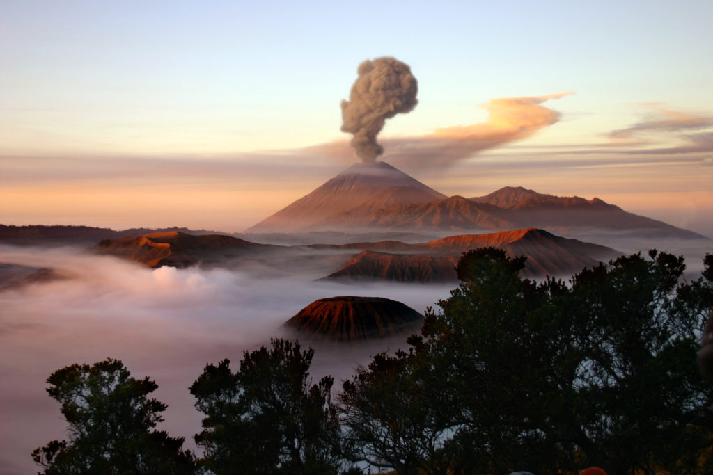Mount Merapi in Java, Indonesia, with a plume of smoke